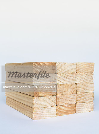 Stack of sawn prepared timber, spruce wood planks or studs, for use. Treated wood in traditional 2 by 4 measured cut shapes. Cut ends. Stock Photo - Premium Royalty-Free, Image code: 6118-07353287