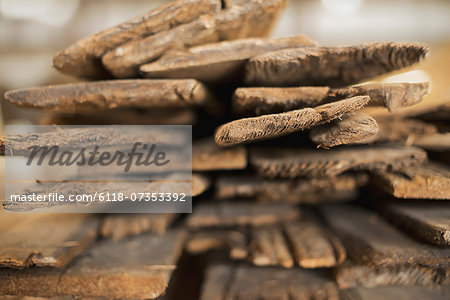 A heap of recycled reclaimed timber planks of wood. Environmentally responsible reclamation in a timber yard. Stock Photo - Premium Royalty-Free, Image code: 6118-07353392