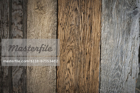 A heap of recycled reclaimed timber planks of wood. Environmentally responsible reclamation in a timber yard. Varieties of wood, with grain and colour details. Stock Photo - Premium Royalty-Free, Image code: 6118-07353402