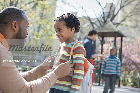 A New York city park in the spring. A family, parents and two boys spending time together. Stock Photo - Premium Royalty-Free, Image code: 6118-07354664