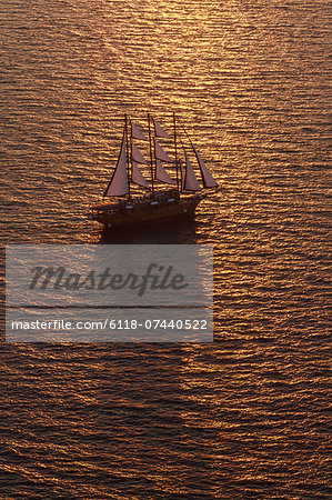 A three-masted sailing ship with full sail on the Aegean Sea at sunset. Stock Photo - Premium Royalty-Free, Image code: 6118-07440522