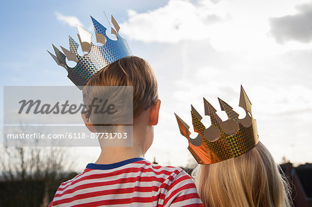 Two children in fancy dress, wearing crowns. Stock Photo - Premium Royalty-Free, Image code: 6118-07731703