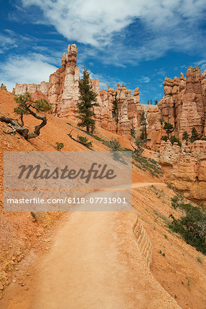 Sandstone pillars and a road through the desert. Stock Photo - Premium Royalty-Free, Image code: 6118-07731901