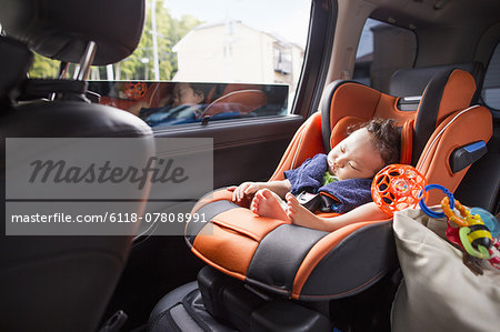 A mother and her young baby boy in a car. Stock Photo - Premium Royalty-Free, Image code: 6118-07808991