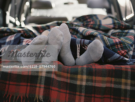 Couple sleeping in the back of their car. Stock Photo - Premium Royalty-Free, Image code: 6118-07944760