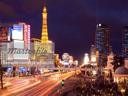 View along the Strip in Las Vegas at night, with the illuminated Paris Las Vegas Hotel and Casino in the background. Stock Photo - Premium Royalty-Free, Image code: 6118-08140285