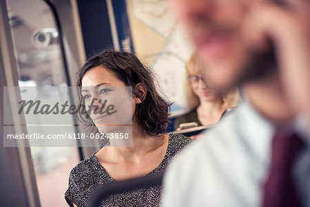 A woman on a busy bus looking out of the window Stock Photo - Premium Royalty-Free, Image code: 6118-08243850