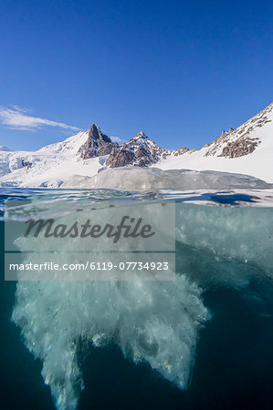 Above and below view of glacial ice in Orne Harbor, Antarctica, Polar Regions Stock Photo - Premium Royalty-Free, Image code: 6119-07734923