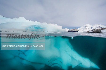 Above and below view of glacial ice near Wiencke Island, Neumayer Channel, Antarctica, Polar Regions Stock Photo - Premium Royalty-Free, Image code: 6119-07734926