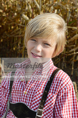 Boy in cornfield, Bavaria, Germany Stock Photo - Premium Royalty-Free, Image code: 6121-07739944