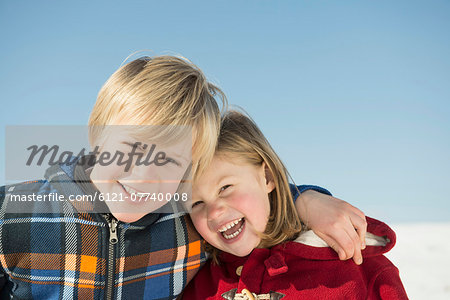 Portrait of girl and boy, smiling, Bavaria, Germany Stock Photo - Premium Royalty-Free, Image code: 6121-07740008
