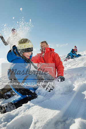 Family having snowball fight, Bavaria, Germany Stock Photo - Premium Royalty-Free, Image code: 6121-07740072