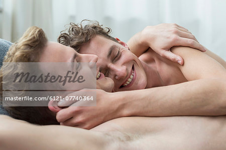 Homosexual couple hugging each other, smiling Stock Photo - Premium Royalty-Free, Image code: 6121-07740364