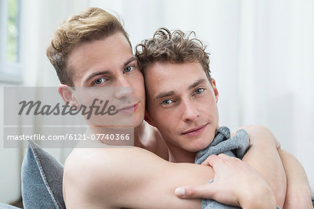 Portrait of homosexual couple hugging each other, close up Stock Photo - Premium Royalty-Free, Image code: 6121-07740366