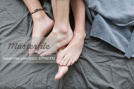 Homosexual couple in bed, close up Stock Photo - Premium Royalty-Free, Image code: 6121-07740372