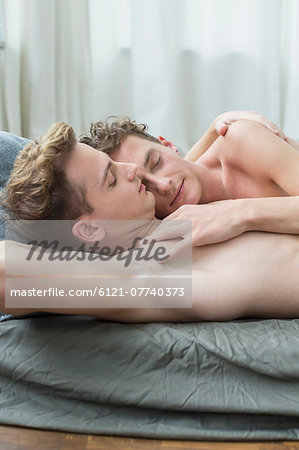 Homosexual couple sleeping in bed, close up Stock Photo - Premium Royalty-Free, Image code: 6121-07740373