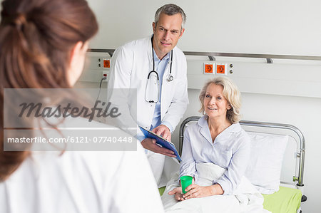 Doctors' visit in hospital Stock Photo - Premium Royalty-Free, Image code: 6121-07740448