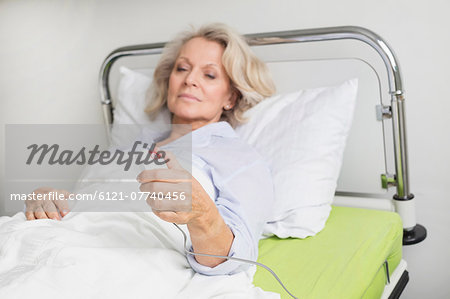 Patient in hospital ringing for nurse Stock Photo - Premium Royalty-Free, Image code: 6121-07740456