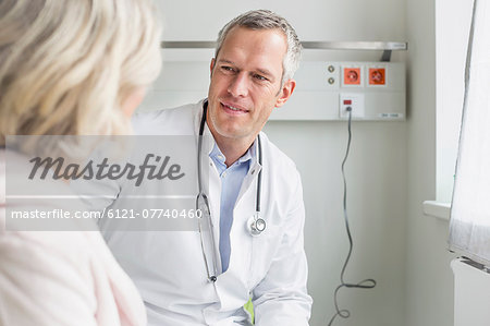Doctor listening to patient Stock Photo - Premium Royalty-Free, Image code: 6121-07740460