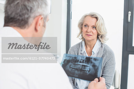 Doctor discussing treatment with patient Stock Photo - Premium Royalty-Free, Image code: 6121-07740473