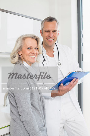 Doctor discussing treatment with patient Stock Photo - Premium Royalty-Free, Image code: 6121-07740477