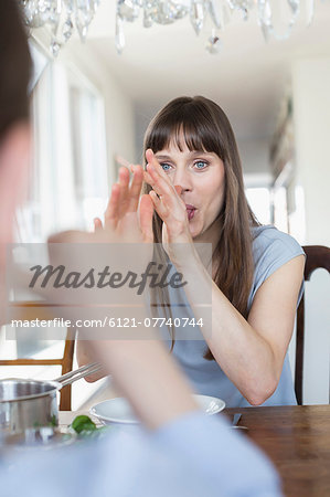 Mid adult woman making funny faces Stock Photo - Premium Royalty-Free, Image code: 6121-07740744