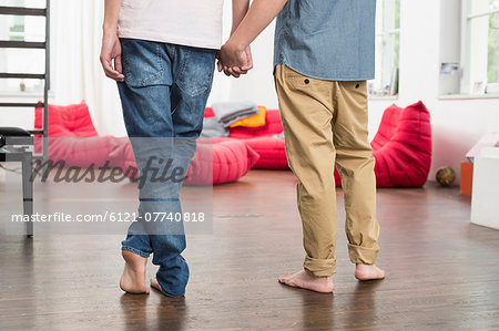 Homosexual couple holding hands, close up Stock Photo - Premium Royalty-Free, Image code: 6121-07740818