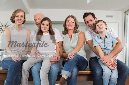 Smiling extended family side by side, portrait Stock Photo - Premium Royalty-Free, Image code: 6121-07741084