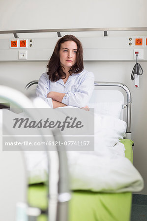 Patient in hospital lying in bed Stock Photo - Premium Royalty-Free, Image code: 6121-07741157