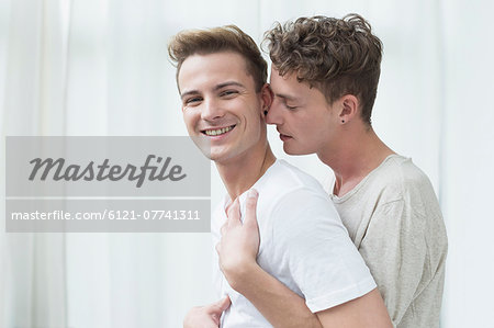 Homosexual couple embracing each other, smiling Stock Photo - Premium Royalty-Free, Image code: 6121-07741311