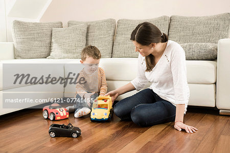 Mother and son playing with toys Stock Photo - Premium Royalty-Free, Image code: 6121-07741455