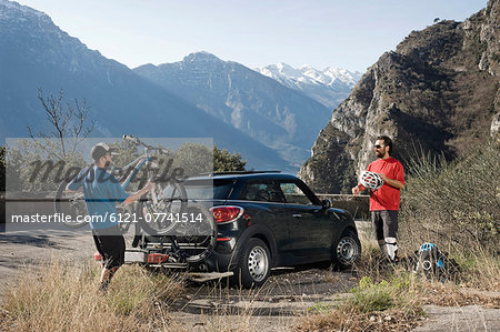 Men taking mountainbikes off car, Italy Stock Photo - Premium Royalty-Free, Image code: 6121-07741514