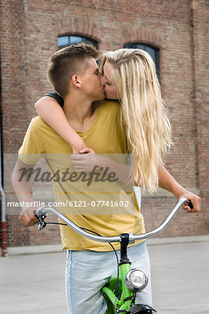 Teenage couple kissing each other Stock Photo - Premium Royalty-Free, Image code: 6121-07741602