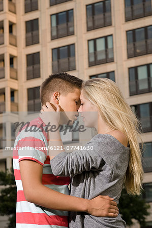 Teenage couple kissing at each other Stock Photo - Premium Royalty-Free, Image code: 6121-07741630
