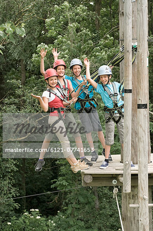 Boys and girls climbing crag, smiling Stock Photo - Premium Royalty-Free, Image code: 6121-07741653