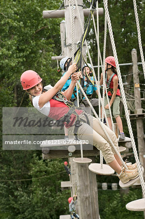 Boys and girls climbing crag, smiling Stock Photo - Premium Royalty-Free, Image code: 6121-07741670