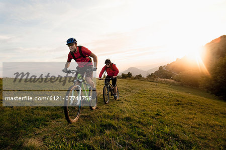 two mountain bikers on the way at sunset, Kolovrat, Istria, Slovenia Stock Photo - Premium Royalty-Free, Image code: 6121-07741758