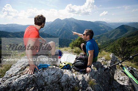 two mountain biker having a rest, Slatnik, Istria, Slovenia Stock Photo - Premium Royalty-Free, Image code: 6121-07741763