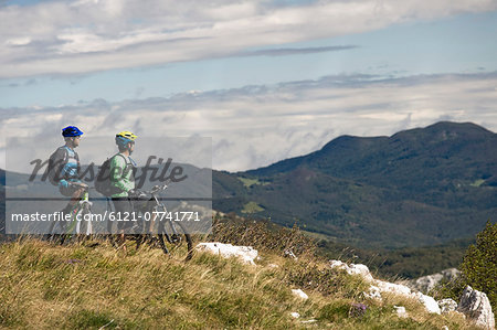 two mountain bikers looking at view, Vipava valley, Istria, Slovenia Stock Photo - Premium Royalty-Free, Image code: 6121-07741771