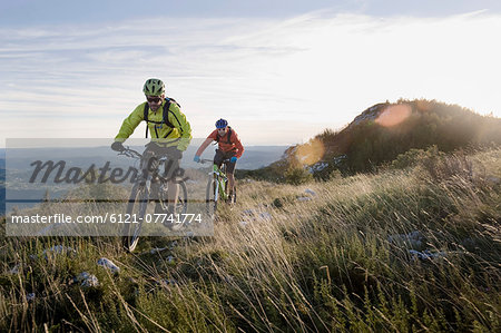 two mountain bikers on the way downhill, Vipava valley, Istria, Slovenia Stock Photo - Premium Royalty-Free, Image code: 6121-07741774