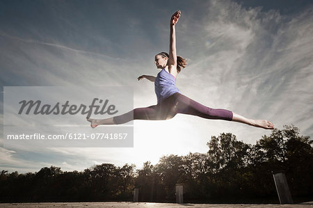 Woman jumpingmid air, Woerthsee, Bavaria, Germany Stock Photo - Premium Royalty-Free, Image code: 6121-07741857