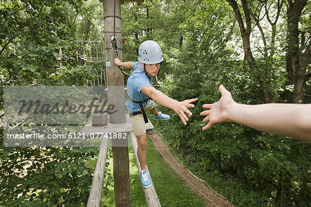 teenager in a climbing crag helping another Stock Photo - Premium Royalty-Free, Image code: 6121-07741882