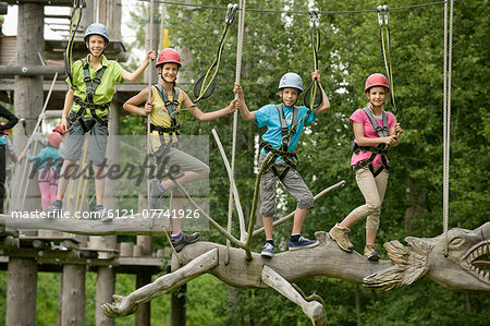 Childrens climbing on crag Stock Photo - Premium Royalty-Free, Image code: 6121-07741926