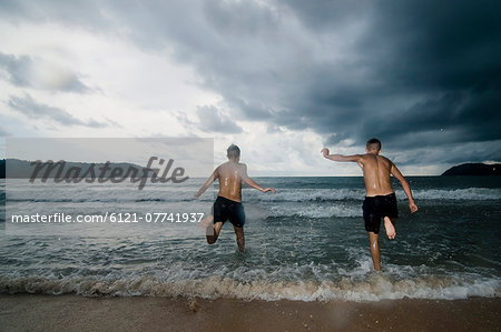 two boys at ocean, Lankawi, Malaysia Stock Photo - Premium Royalty-Free, Image code: 6121-07741937