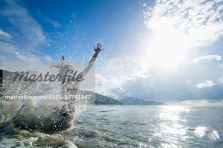 woman jumping into the ocean, Penang, Malaysia Stock Photo - Premium Royalty-Free, Image code: 6121-07741947