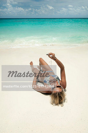 woman listening music on the beach, Koh Lipe, Thailand Stock Photo - Premium Royalty-Free, Image code: 6121-07741956