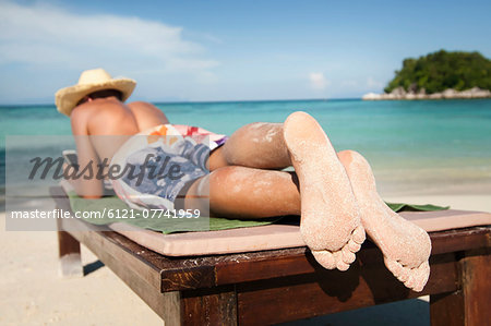 teenage boy hearing music at beach, Koh Lipe, Thailand Stock Photo - Premium Royalty-Free, Image code: 6121-07741959