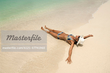 woman lying on the beach, Koh Lipe, Thailand Stock Photo - Premium Royalty-Free, Image code: 6121-07741960