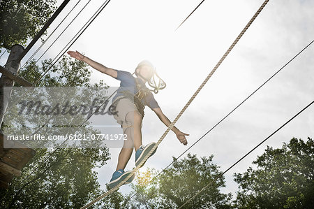 teenager balancing in a climbing crag Stock Photo - Premium Royalty-Free, Image code: 6121-07741972