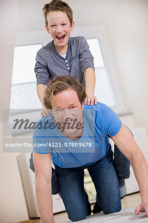 Playful father and son at home Stock Photo - Premium Royalty-Free, Image code: 6121-07809678